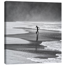 Canvas print  Brazilian boy playing football on beach - Alex Saberi