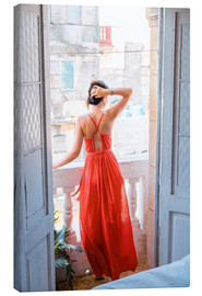 Young attractive woman in red dress
