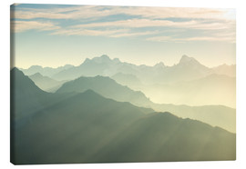 Canvas print  Sunlight behind mountain peaks silhouette, the Alps - Fabio Lamanna