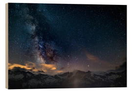 Wood print  The Milky Way galaxy glowing over snowcapped mountains in the Alps - Fabio Lamanna