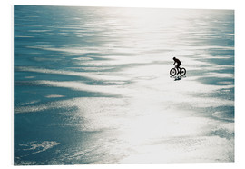 Johner - Man cycling on a frozen lake