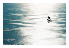 Premium poster Man cycling on a frozen lake