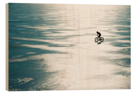 Wood print  Man cycling on a frozen lake - Johner