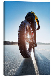 Canvas  Man cycling on a frozen lake - Johner