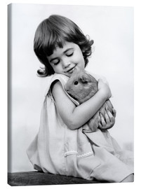 Canvas print  Girl with guinea pig - SuperStock