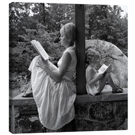 Canvas print  Mother and daughter are reading - SuperStock