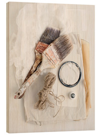 Wood  Still life of decorating brushes and string - Image Source