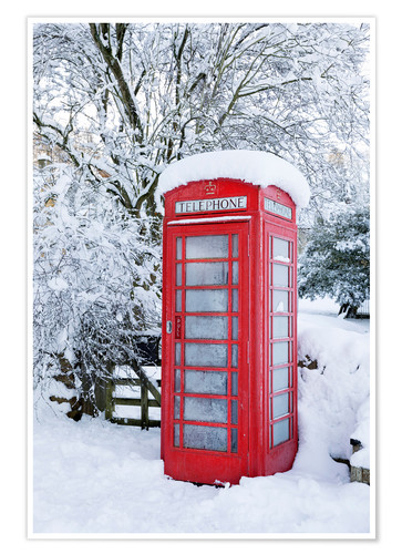 Premium poster Traditional British telephone box in the snow