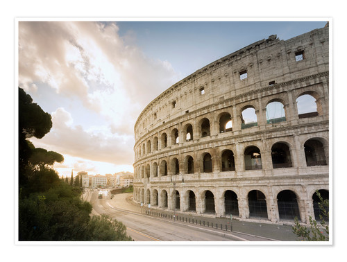 Premium poster The lights of the sunrise frame the ancient Coliseum