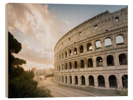 Wood print  The lights of the sunrise frame the ancient Coliseum - Roberto Moiola