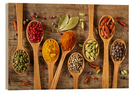 Wood  Colorful spices in wooden spoons - Elena Schweitzer