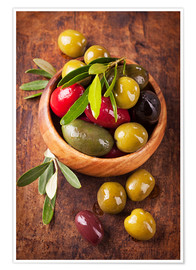 Poster Bowl with olives on a wooden table